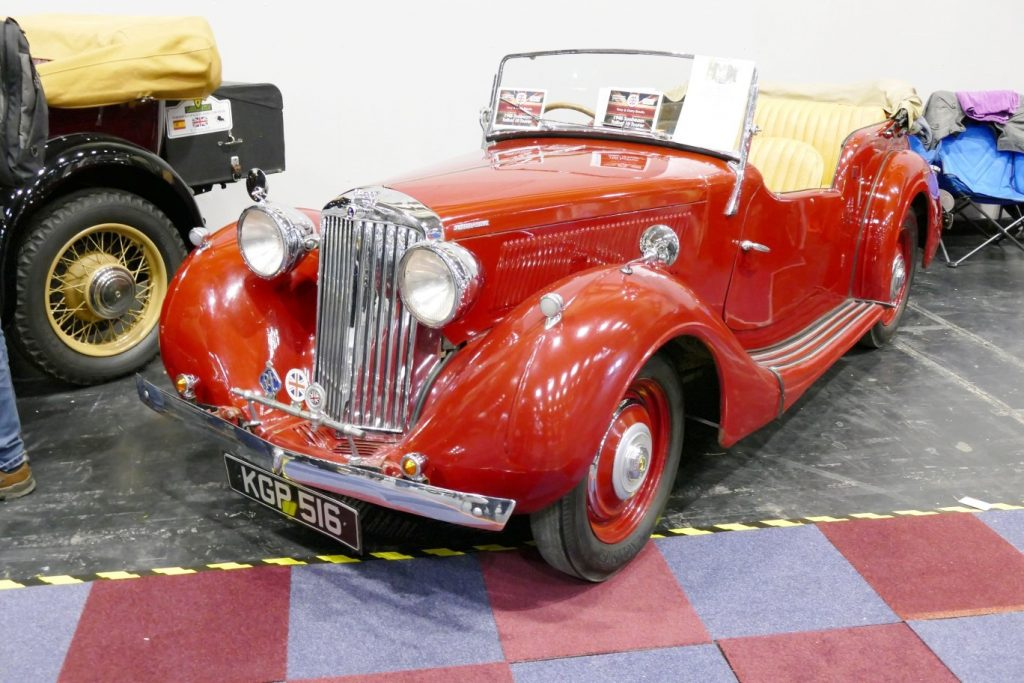 small red car with open top